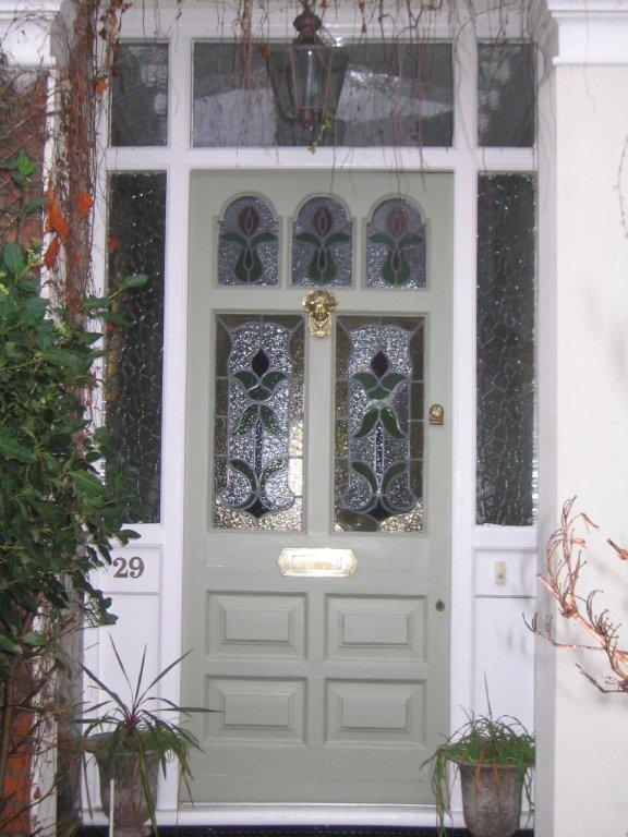 Stain glassed green front door