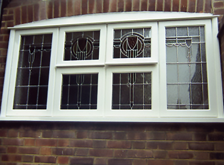 White lead light stain glassed wood window